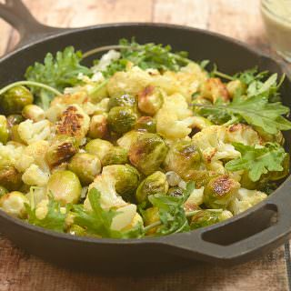 Roasted Brussels Sprouts and Cauliflower Salad is the perfect warm salad to enjoy this summer. With beautifully caramelized vegetables tossed in a refreshing pistou dressing, it's both nutritious and delicious!