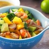 Grilled Shrimp Mango Avocado Salad in a blue serving bowl