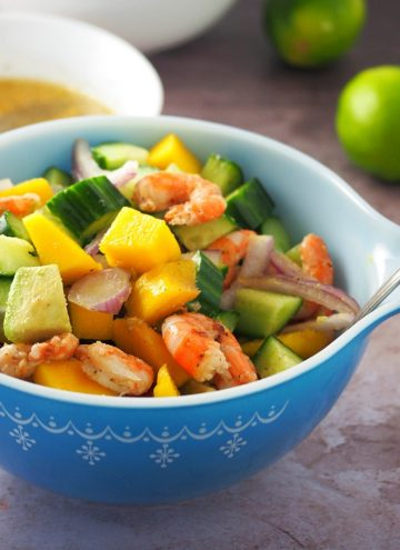 Grilled Shrimp Mango Avocado Salad in a blue serving bowl