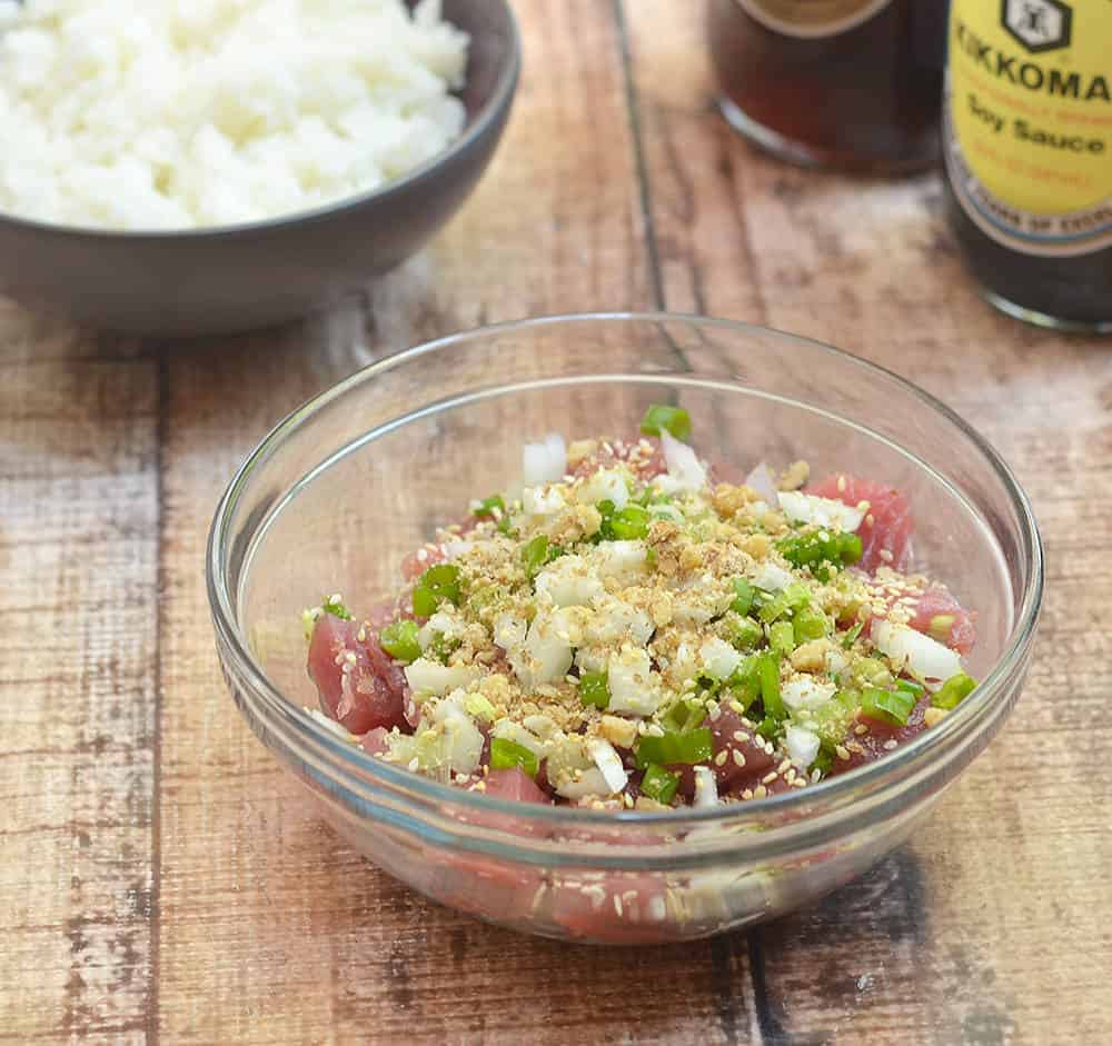 Ahi Shoyu Poke is a Hawaiian raw fish salad made with fresh ahi steaks, onions, macadamia nuts, and seasonings. It's refreshing and healthy meal perfect as an appetizer or entree served over sushi rice.