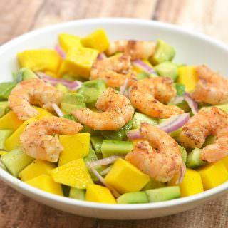 Grilled Shrimp Mango Avocado Salad is a refreshing medley of flavors you'd love as a side dish or a light lunch. Chock-full of grilled shrimps, juicy mangoes, creamy avocados, and crisp cucumbers in a tangy honey lime dressing, it's healthy and delicious.