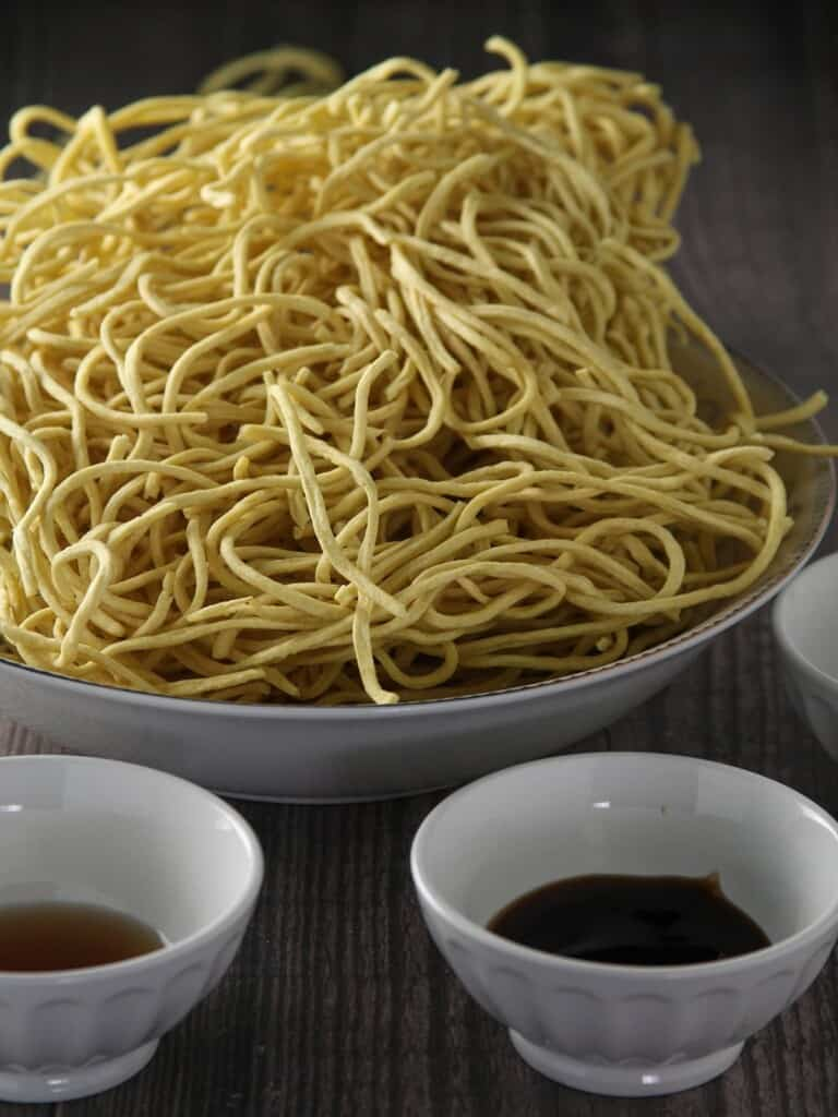 noodles, brown sugar, soy sauce, oyster sauce in individual bowls