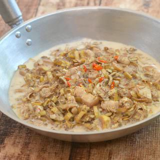 Ginataang Puso ng Saging is a delicious vegetable dish made with banana heart, diced pork, and chili peppers in a rich coconut sauce. Rich, creamy and tasty, it's the perfect accompaniment to grilled meat or fish.