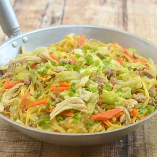 Pancit Langlang is a delicious combination of fresh miki and cellophane noodles with ground pork, flaked chicken, and tender-crisp vegetables. Hearty and tasty, it's perfect for family dinners or special gatherings.
