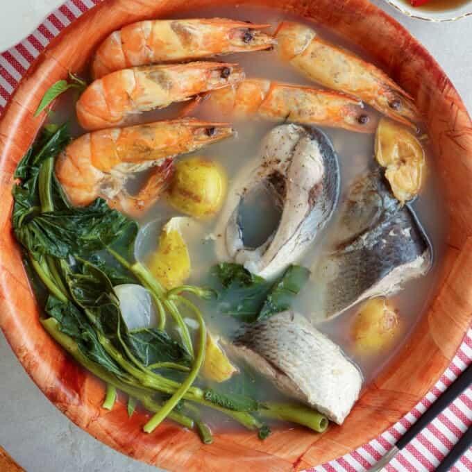 Bulanglang na Bangus at Hipon in a wooden serving bowl