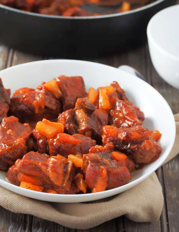 Spare Ribs with Ketchup and Pineapple in a white serving bowl