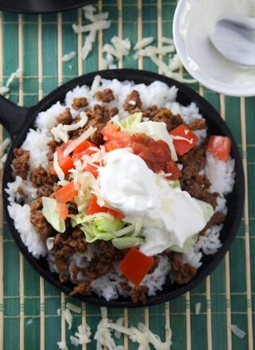 Japanese taco rice in a cast-iron skillet