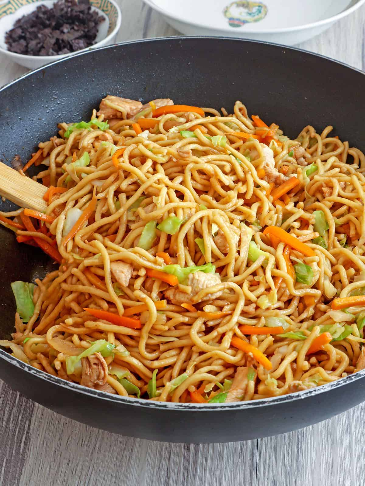 yakisoba with chicken and vegetables in a pan