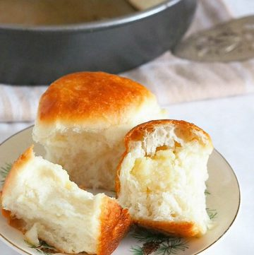 bread rolls with yema filling on a white plate