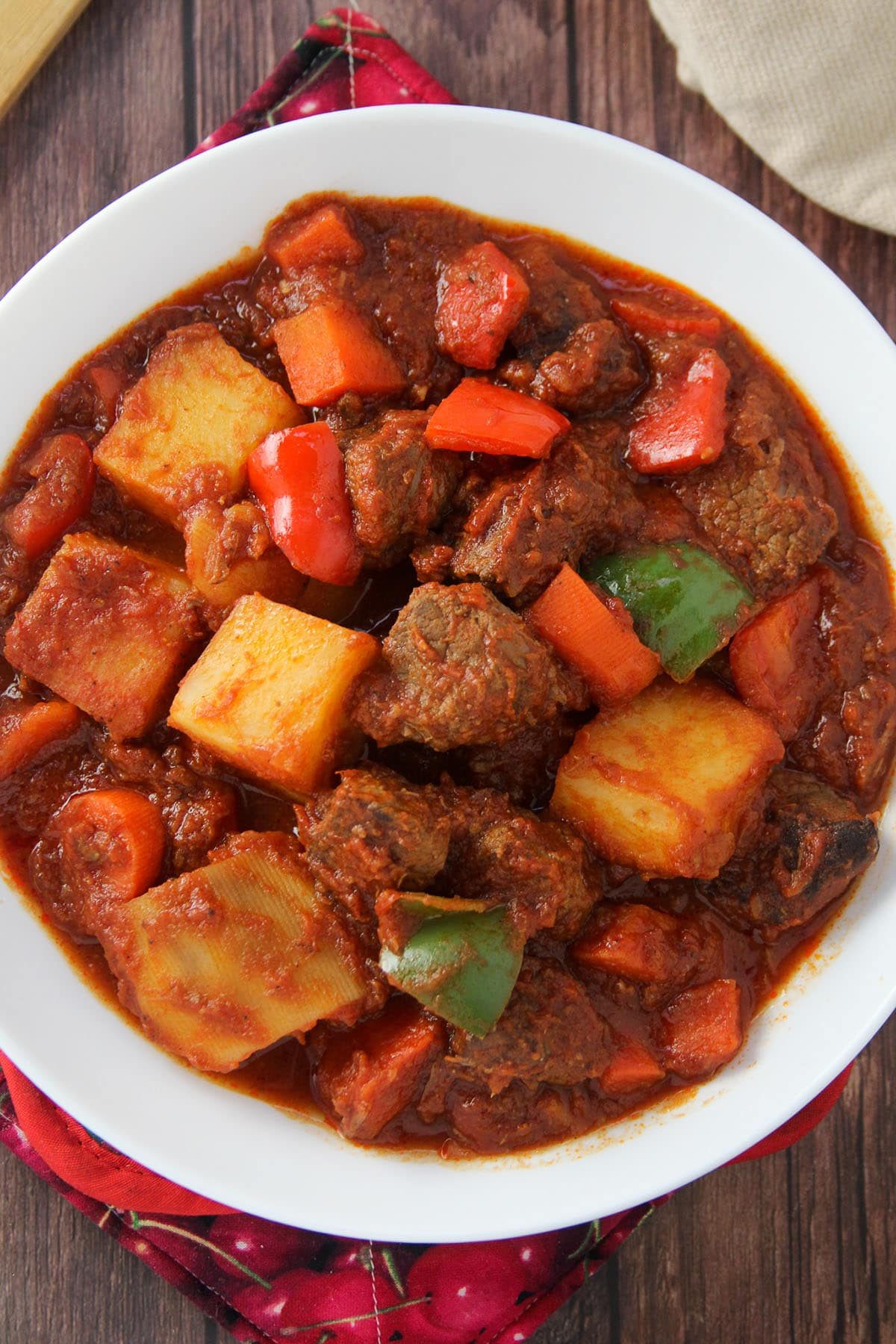 Beef Afritada in a white serving bowl