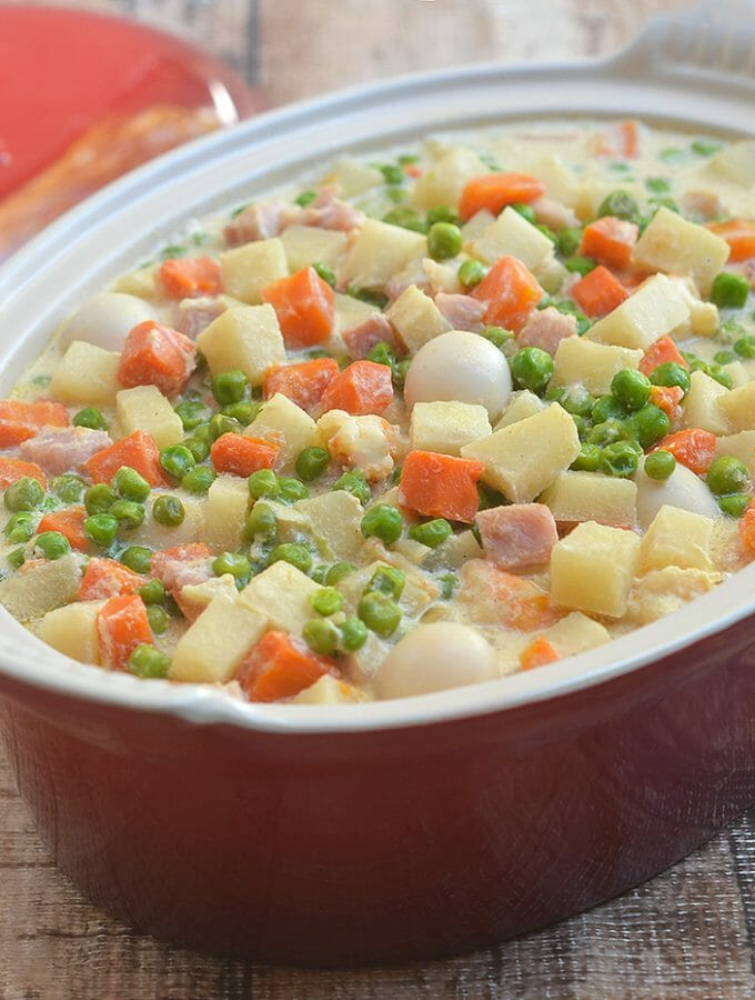 Sipo Egg with Shrimp and Ham is the perfect party dish. With mixed vegetables, shrimp and ham smothered in a creamy sauce, it's a sure crowd pleaser!