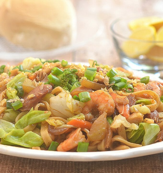 Pancit Lomi Guisado with fresh egg noodles, chicken, sausage, shrimp, and vegetables is a hearty dish the whole family is sure to love. Perfect for midday snack or dinner meal!