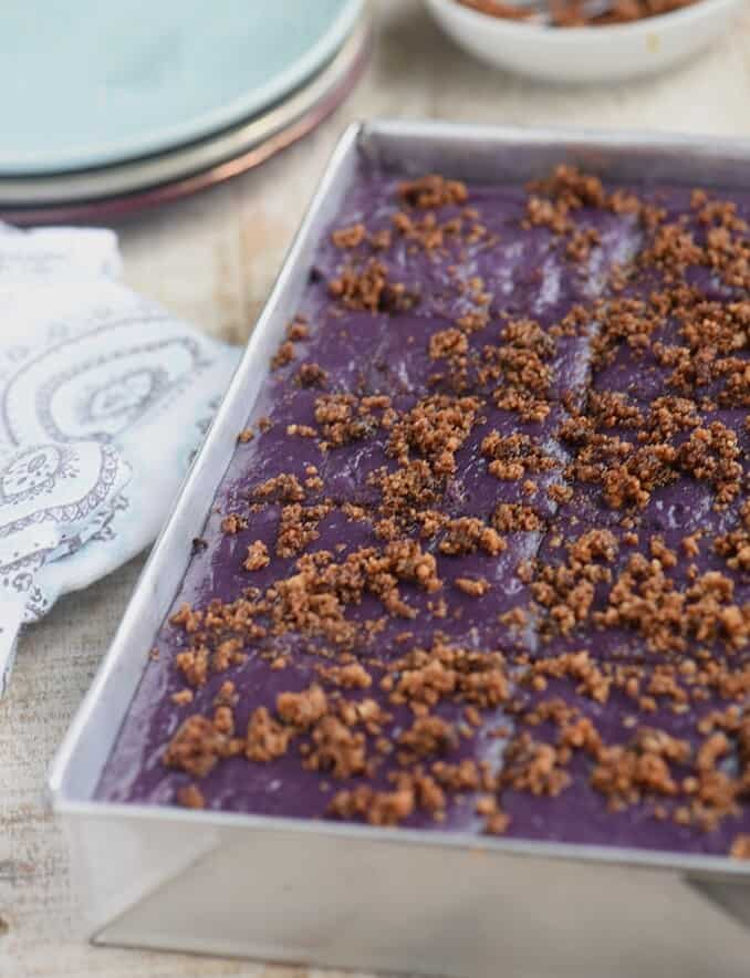Ube Kalamay with latik topping in an aluminum pan