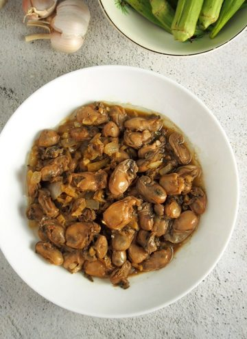 Adobong talaba in a white serving bowl