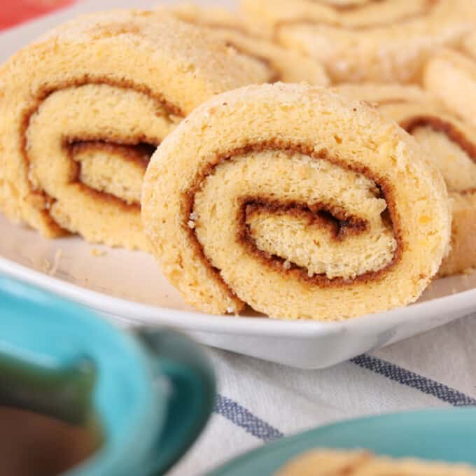 sliced Filipino jelly roll on a white platter
