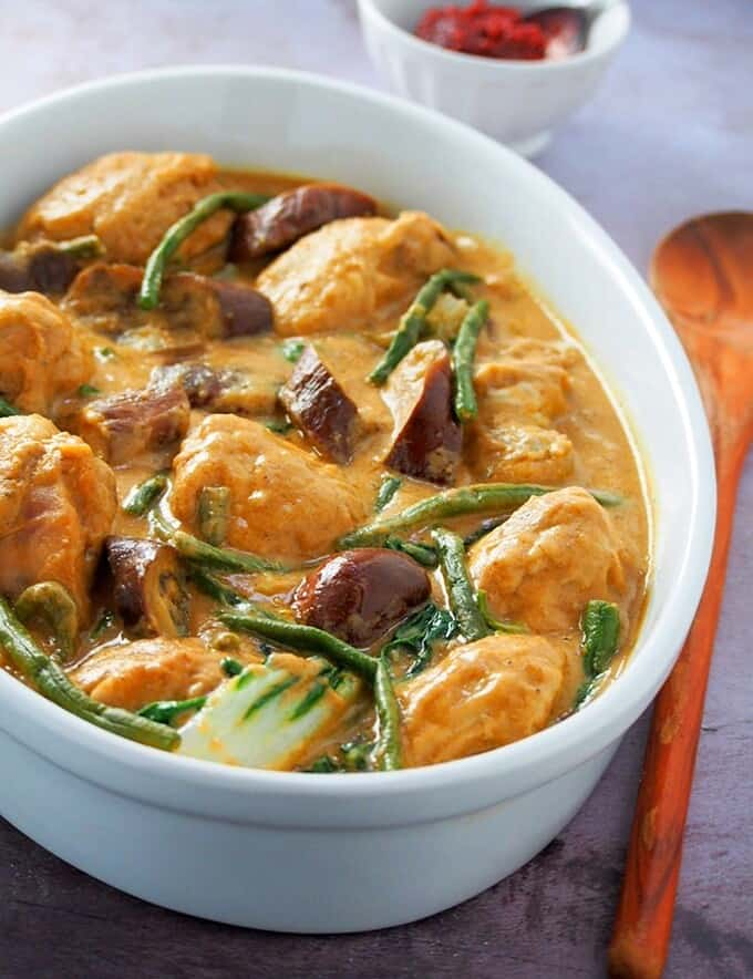 Chicken Kare-Kare in a white serving dish