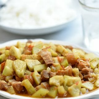 Ginisang Upo with Pork made with tender-crisp bottle gourd squash and tasty pork belly strips. A delicious vegetable dish you'll love with steamed rice or on its own!