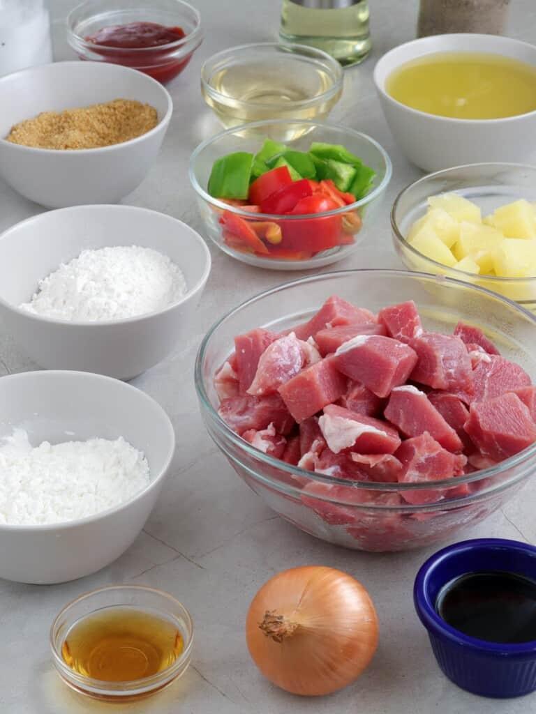 diced pork, onion, cornstarch, bell peppers, pineapple chunks, soy sauce, flour
