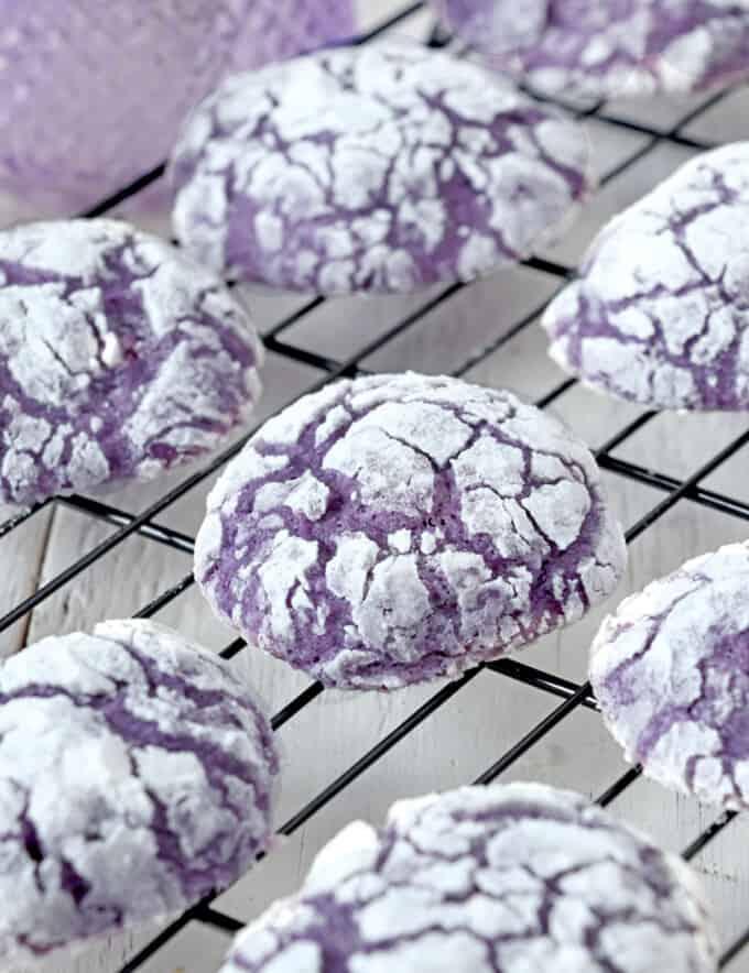 Ube Crinkle Cookies on a wire rack