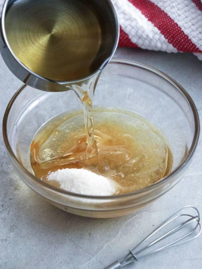 making vinaigrette dressing in a bowl