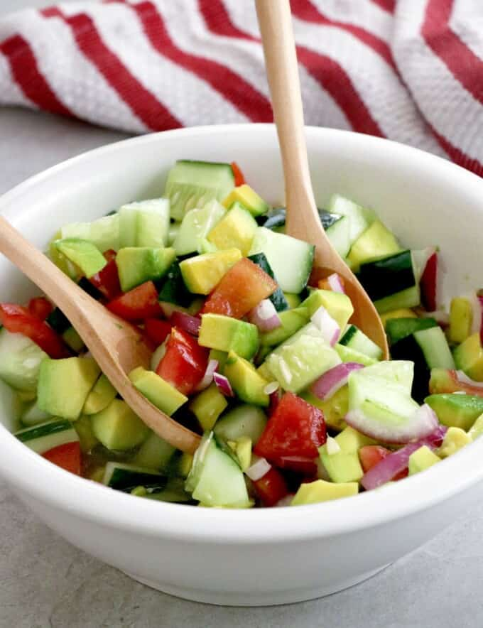 Asian Cucumber Tomato Avocado Salad tossed in a large serving bowl