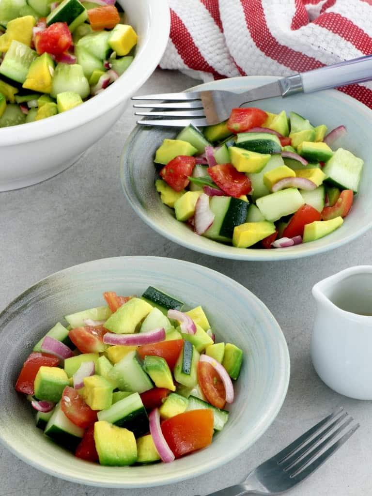 cucumber avocado salad in serving bowls