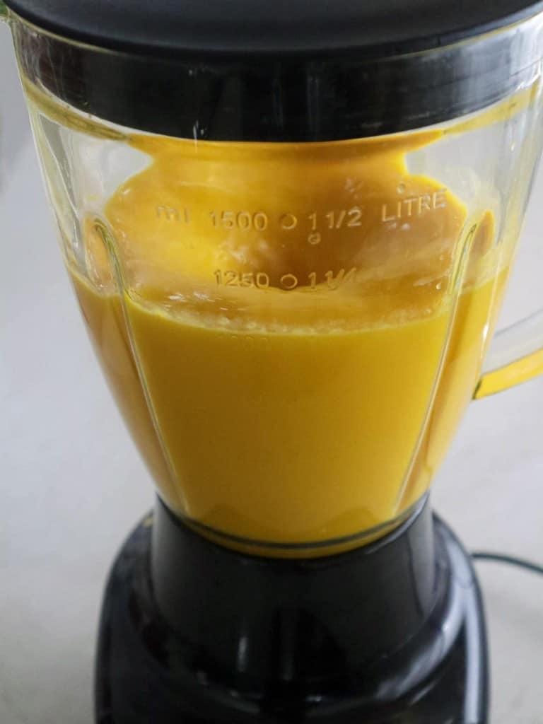 pureeing mango in a blender