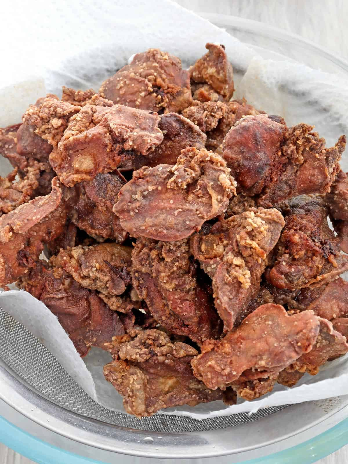 crispy fried chicken livers on a paper-lined plate