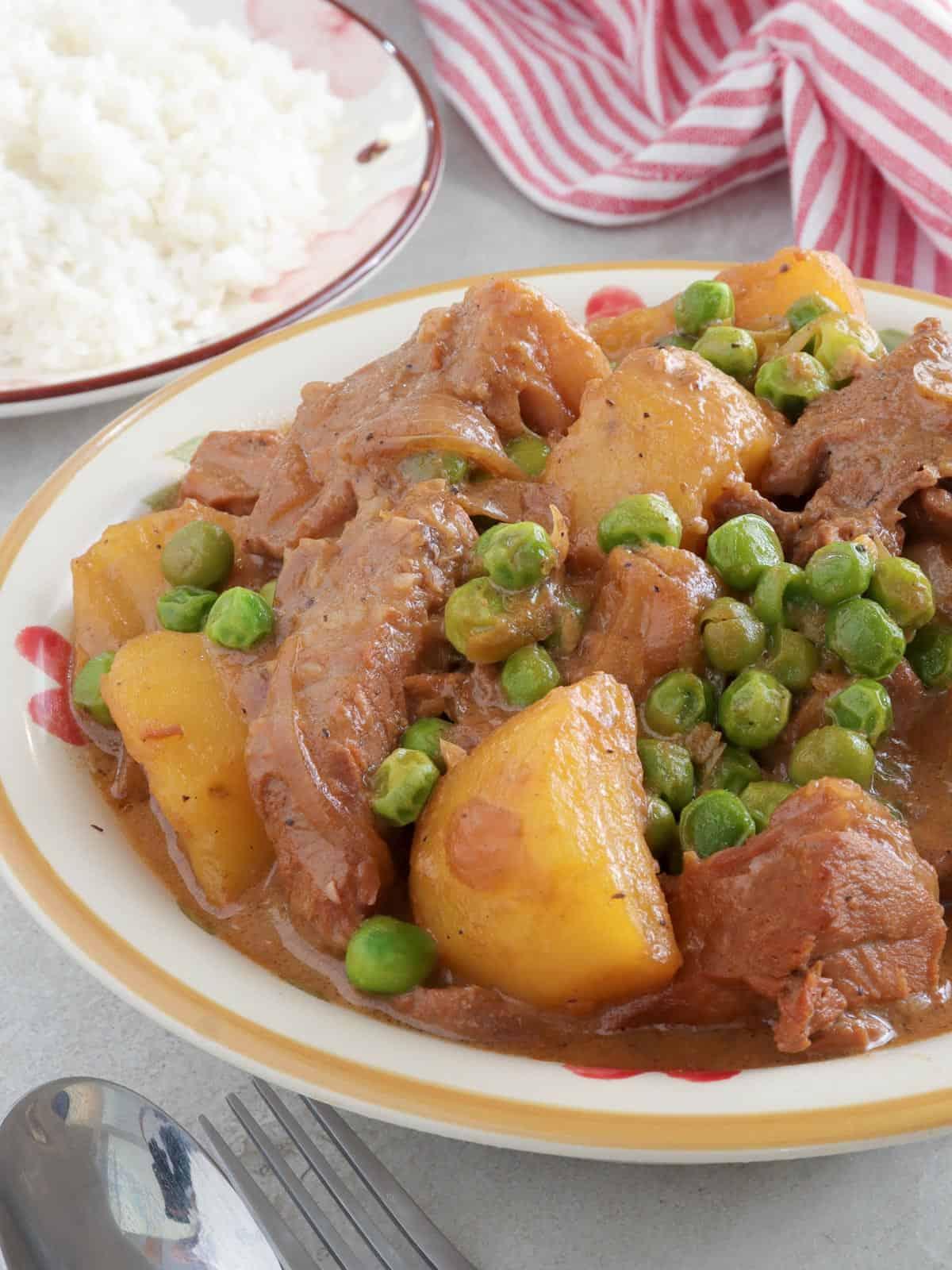 Pork kaldereta a la Quezon Province in a white serving bowl