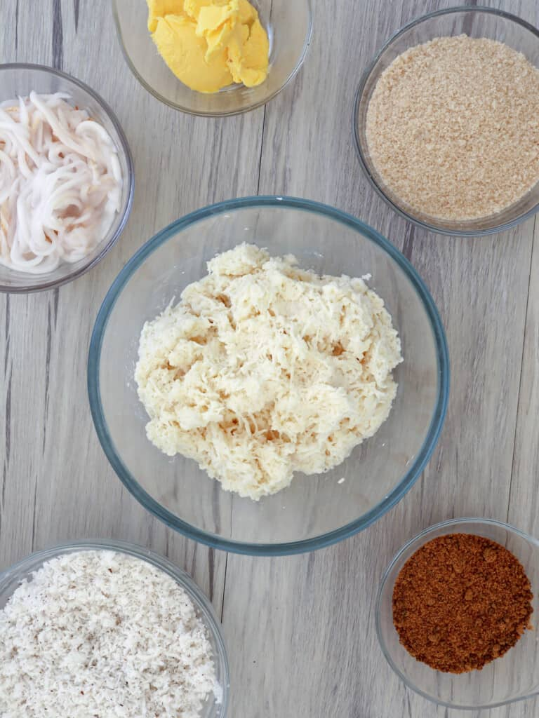 grated cassava, brown sugar, shredded buko, grated coconut, sugar, margarine in individual bowls
