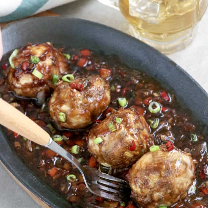 balut served sizzling style in a spicy and savory sauce
