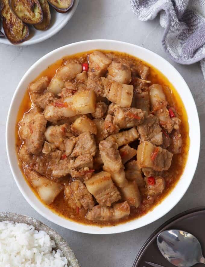 pork binagoongan in a white bowl