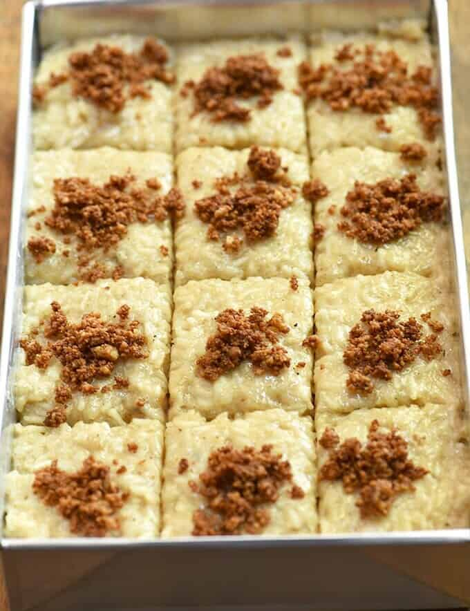 Biko topped with coconut curds or latik in an aluminum pan