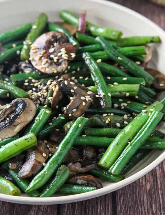 green beans stir-fry with mushrooms in a bowl