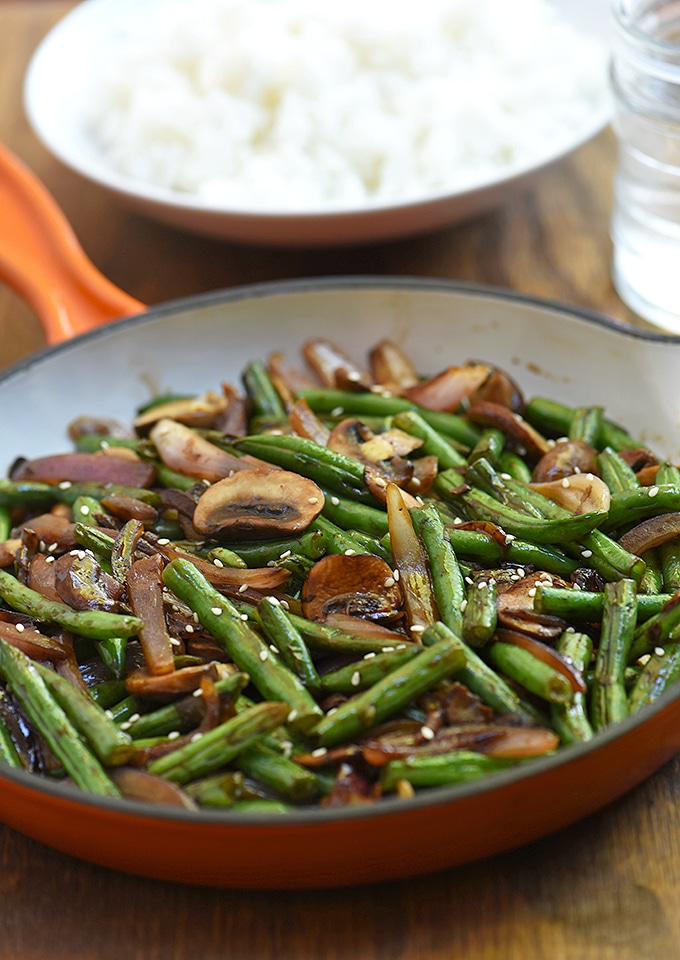 Green Bean Mushroom Stir-fry in an orange enameled cast iron skillet