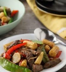 Beef and Baby Corn Stir-fry on a white plate