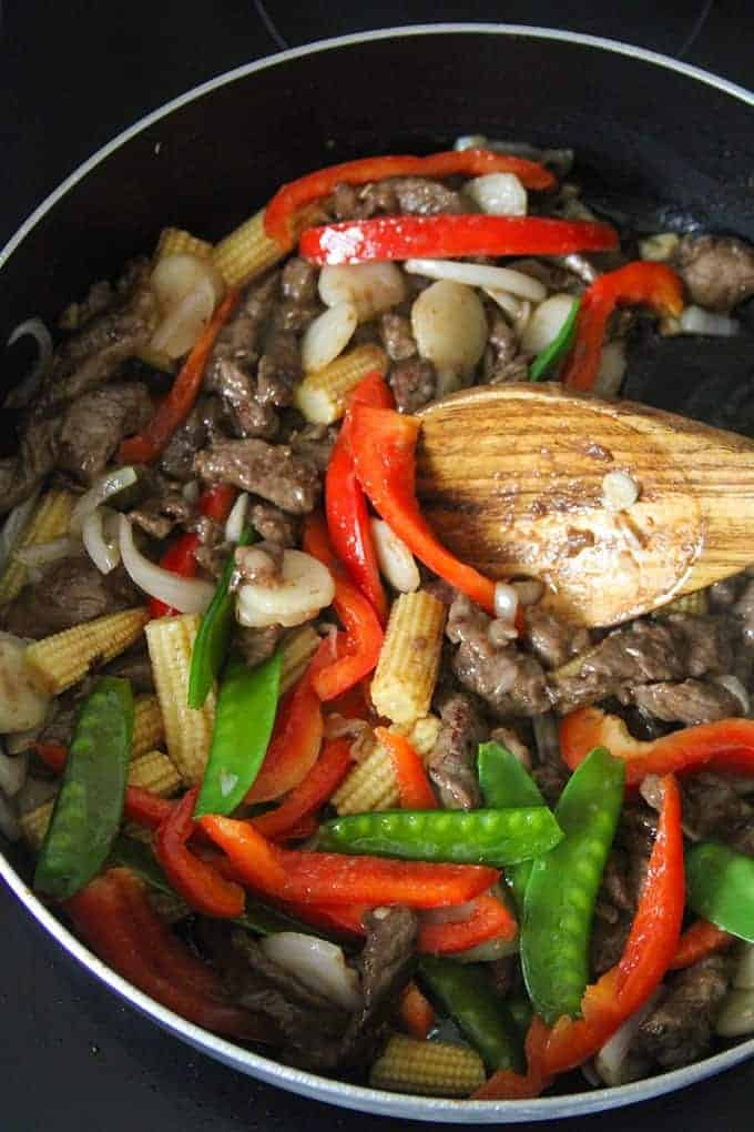 beef stir-fry with veggies in cooked in a pan