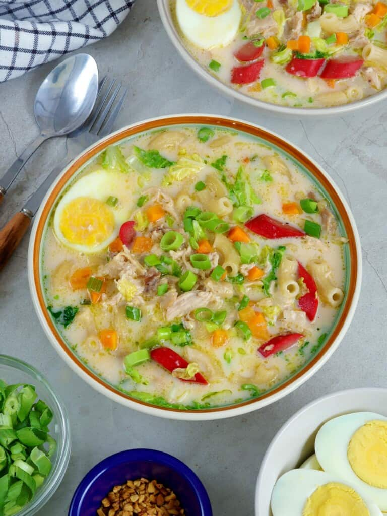 Chicken Sopas with eggs and hot dogs in a serving bowl