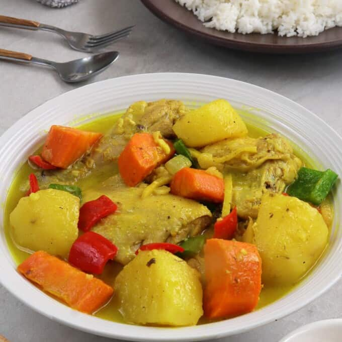coconut chicken curry on a white serving plate