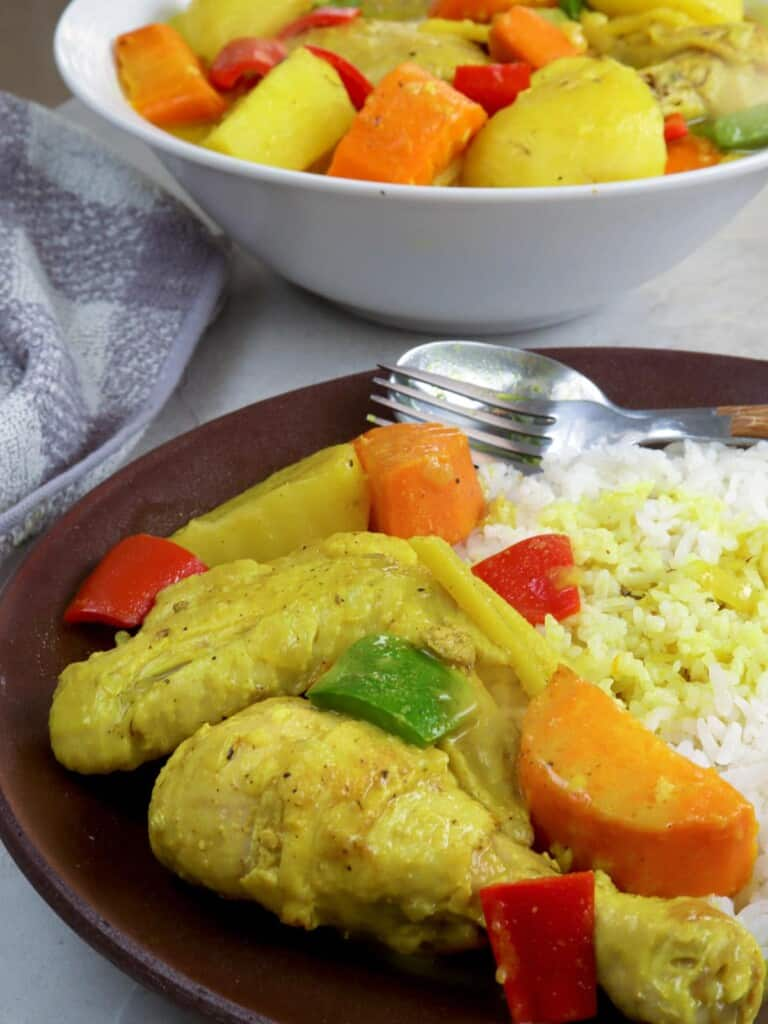 coconut chicken curry on a brown plate with steamed rice