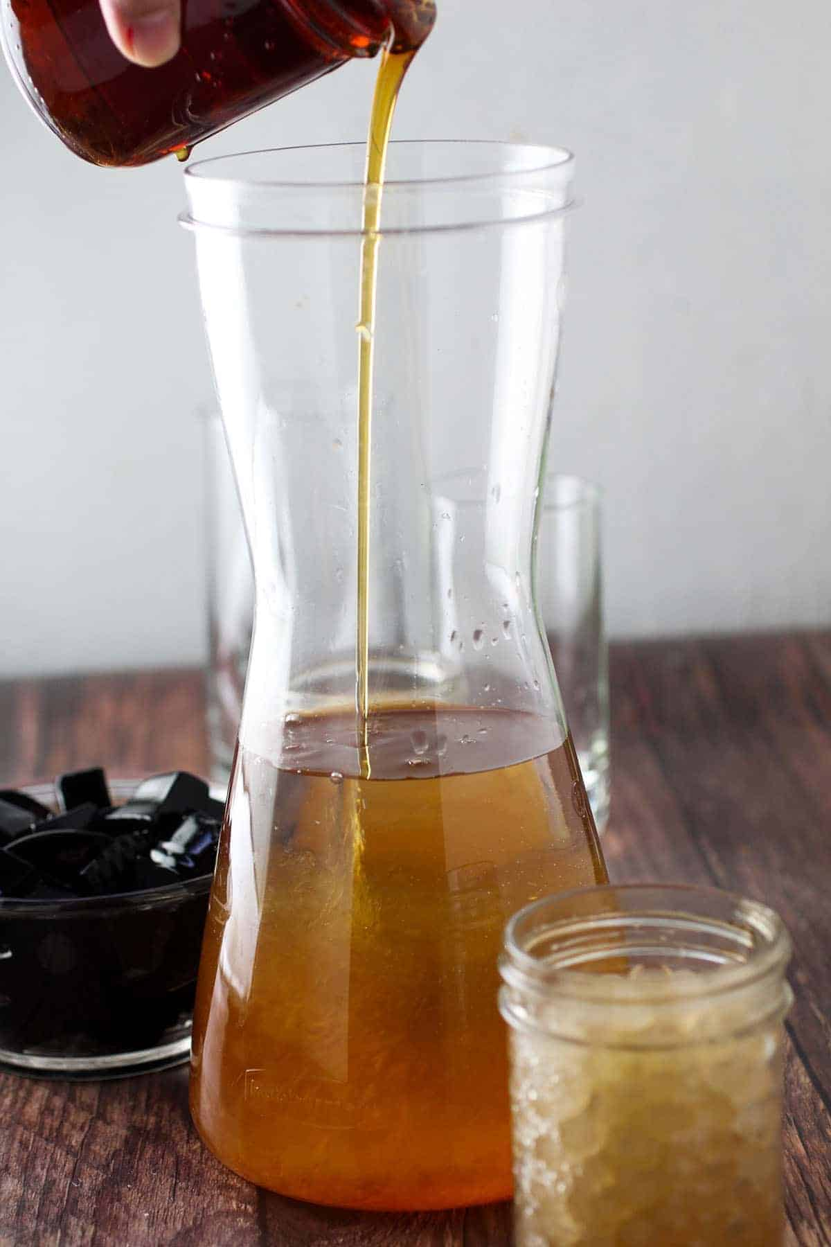 pouring syrup into a pitcher