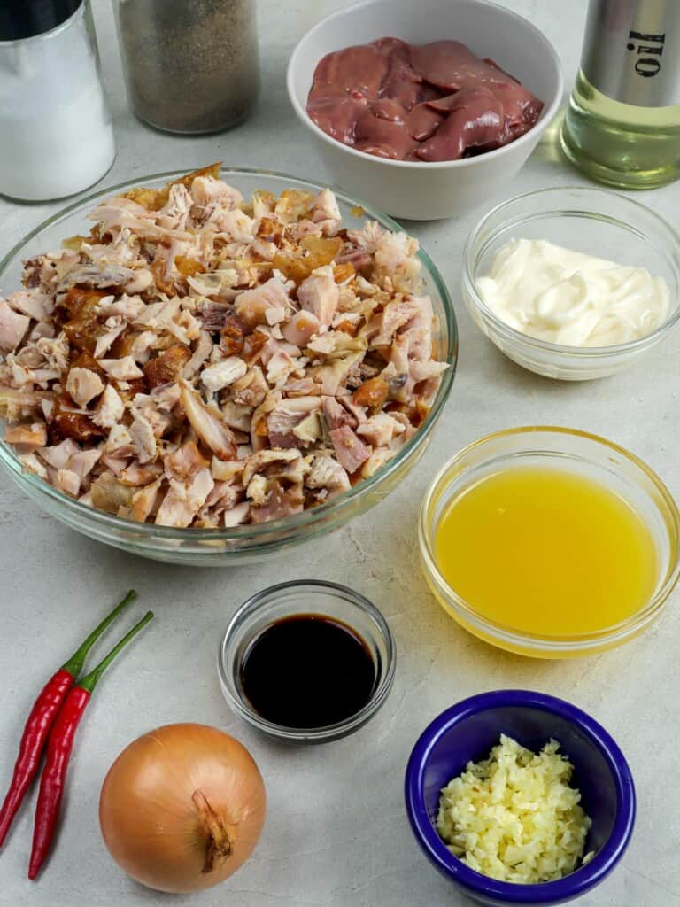 chopped chicken, onions, garlic, soy sauce, chili peppers, calamansi juice, chicken liver