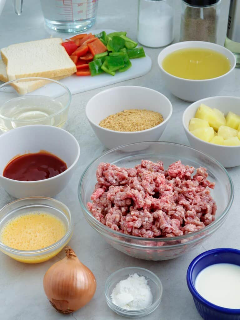 ground pork, pineapple chunks, bell peppers, milk, ketchup, sliced bread, onion, pineapple juice, ketchup, brown sugar