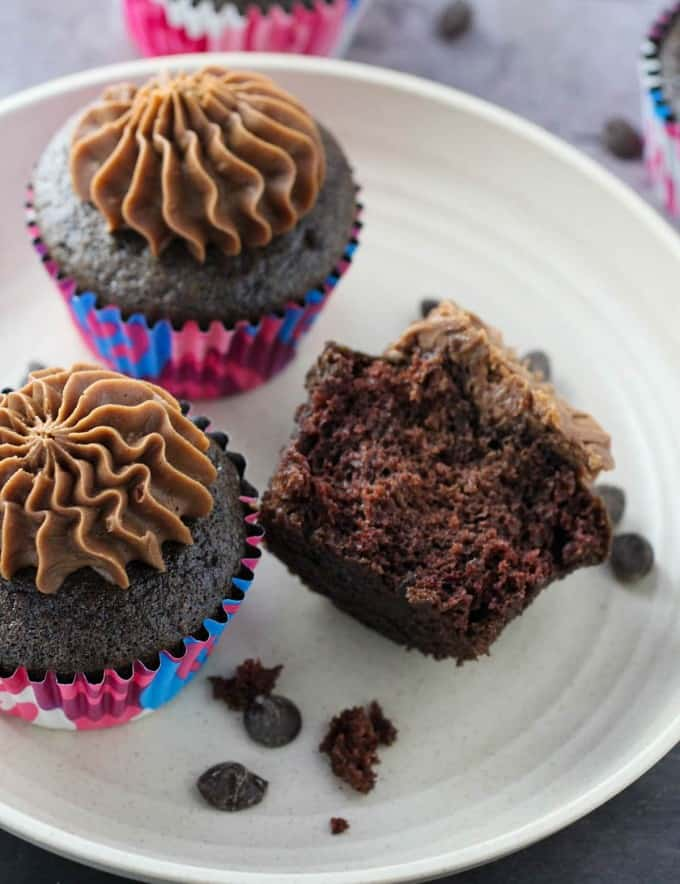 Moist Chocolate Cupcakes with Mocha Buttercream Frosting on a white plate