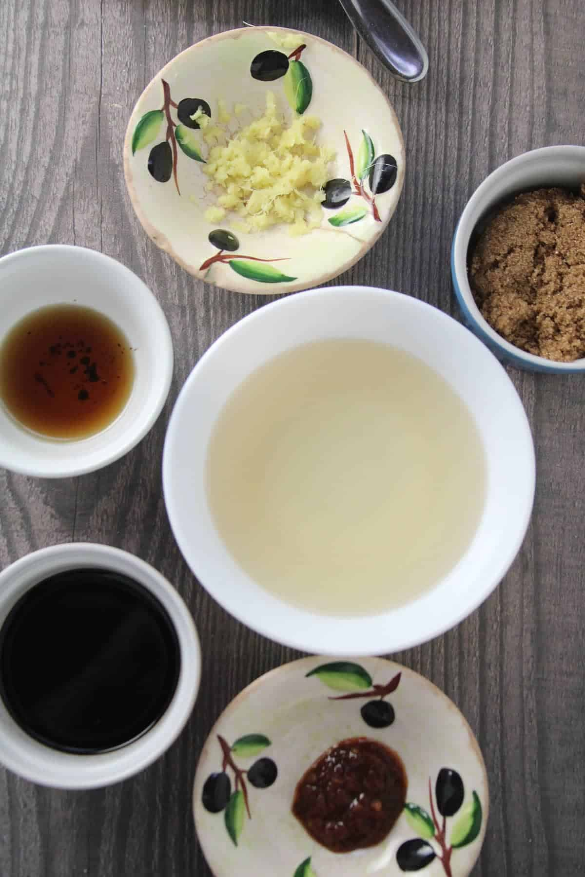 ingredients for Asian Sesame Dressing in small bowls