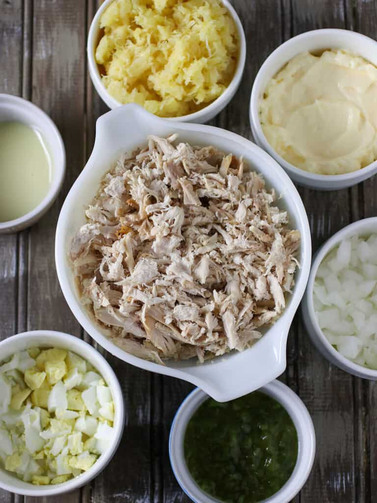 shredded chicken, chopped eggs, crushed pineapple, sweet relish in bowls