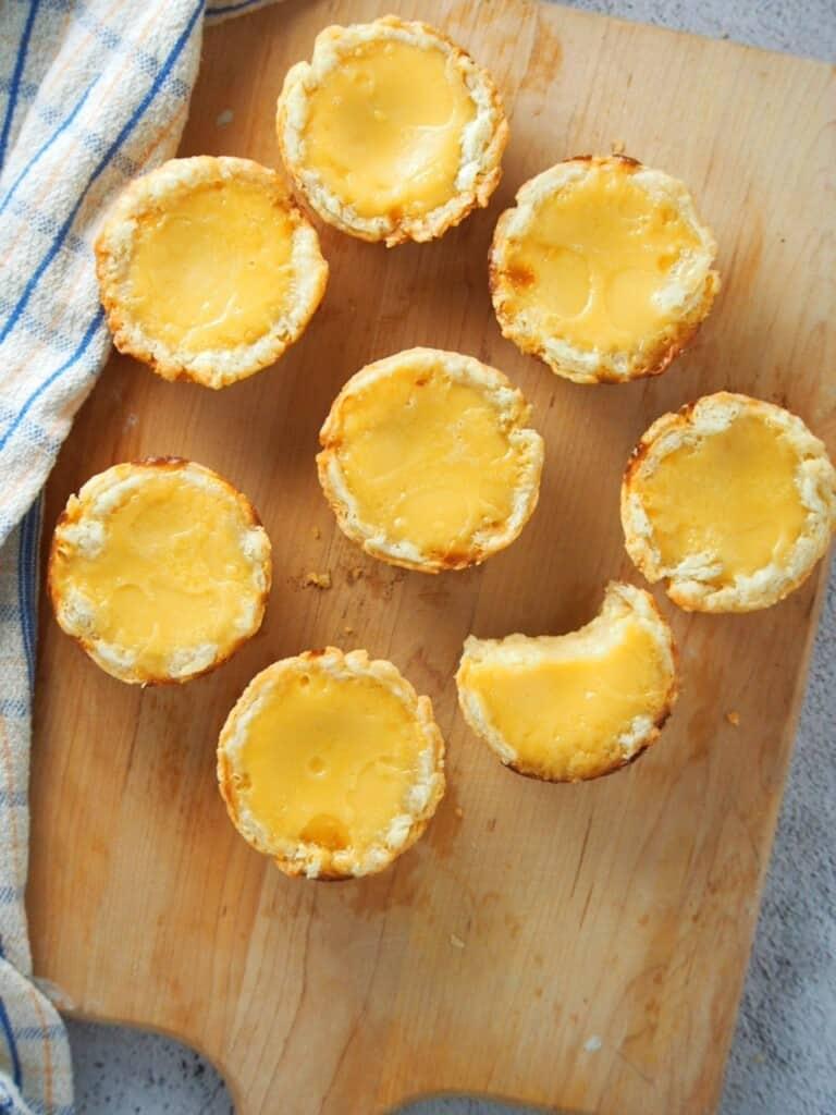 Mini egg pies on a cutting board