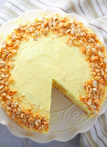 sliced sans rival cake on a white platter