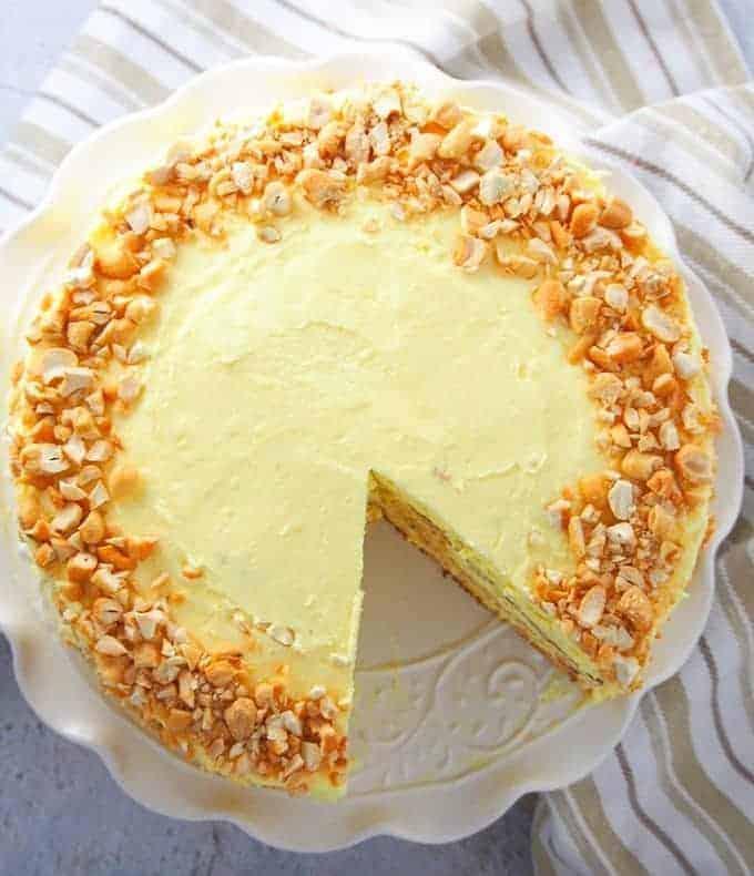sliced sans rival cake on a white platter