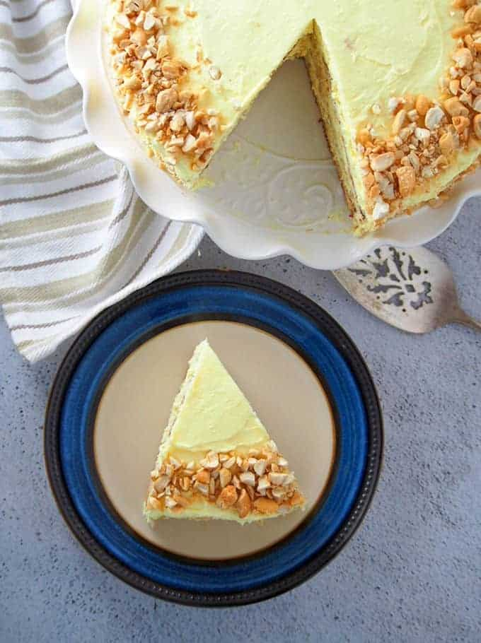 a slice of Sans Rival cake on a serving plate and cut cake on the side